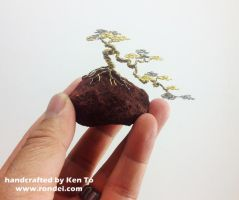 Gold and Silver wire cascade bonsai tree on a rock by KenToArt