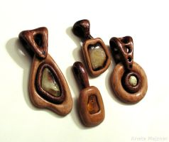 Simple wooden pendants with natural baltic amber by AmberSculpture
