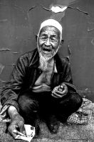 Old Chinese beggar outside the Lama Temple Beijing by Studio5Graphics