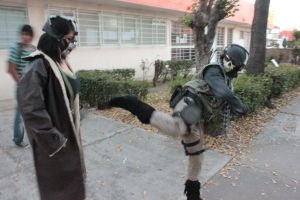 Ghost (MW2) fighting with Female Bane (TDKR) by PrincessOfCrime
