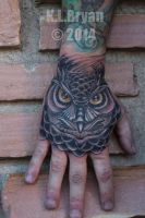 Traditional owl tattoo on hand by danktat