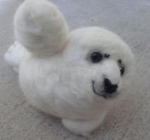 Needle felted Harp Seal-flippers by Throughawolfseyes