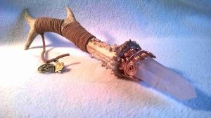 A deer antler and rose quartz wand by InVistaArts