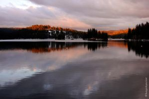 Bright sky on a winter lake by kayaksailor