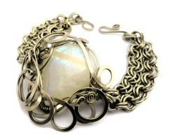 Wire Wrap Metal Bracelet by hyppiechic