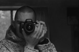 The Man Behind the Lens by SilentFrenzy