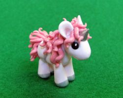 Pink Unicorn by DragonsAndBeasties