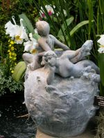 Fairy sculpture and orchids 1 by Reyphotos