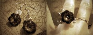 Flower earrings and ring by StaticSkies