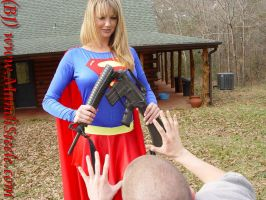 supergirl destroys a rifle by ilikesuperwomens