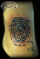 Flower on ribs by state-of-art-tattoo