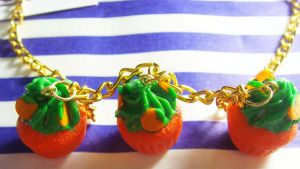 Pumpkin  Cupcake Necklace by tyney123
