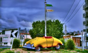 Yellow car on roundabout by djzontheball