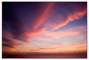 Pink evening clouds over the Carribean Sea. by Dewardb