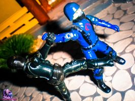 Snake Eyes Fights 2 by MsComicStar86
