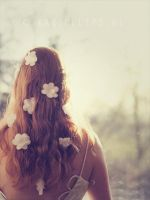 Flowers in her hair by karinelips