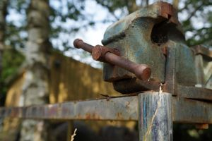 Rusty Vise Outdoors On Rusty Metal Table by BKnutsson