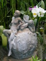 Fairy sculpture and orchids 2 by Reyphotos