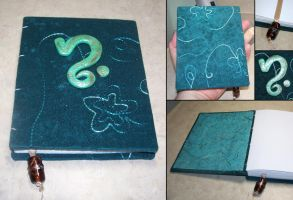 Embroidered suede book by elvaniel