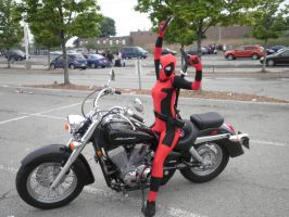 Deadpool on a Motorcycle by Red-Shawnz