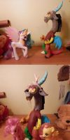 Discord with ponies by St0oiE