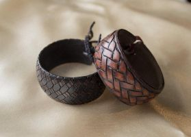Snakeskin and braided bracelets by valentinnikolaevich