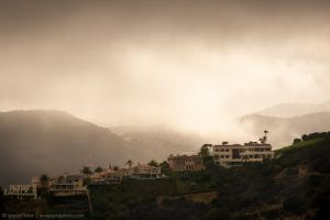 Glowing clouds rolling over the hill by isotophoto