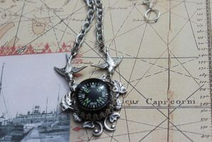 Compass Necklace Carried by Birds Glows by artistiquejewelry