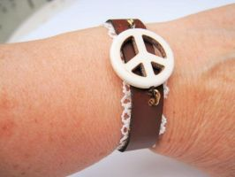 Leather peace bracelet by helpmeplease55