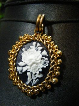 roses in brass cameo by BacktoEarthCreations