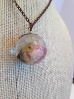Resin sphere necklace with pink rosebud by theevergreenburrow