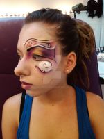 Colourful face painting by dokuneko