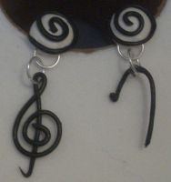 Clef earrings by estranged-illusions