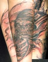 reaper with a gun by justinstattoos