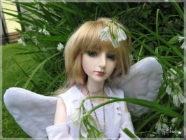 Angel in the Snowdrops by Llrael