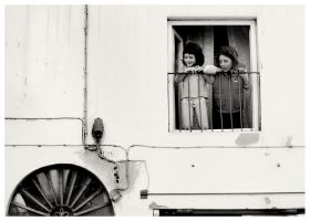 .little girls at the window by dippedFEATHER