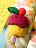 Felt cupcake brooch by moonwolf17