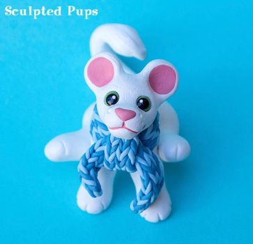 White lion cub sculpture with scarf by SculptedPups