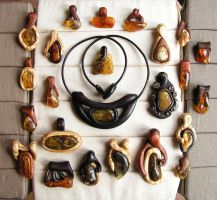 Hand carved wooden pendants with amber by AmberSculpture