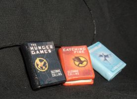 The Hunger Games Charms by Geisha-Neko