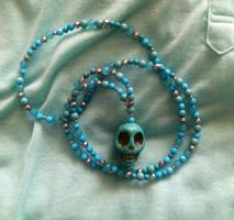 Skull Necklace by broom-rider