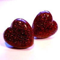 Red resin heart rings by The-Cute-Storm