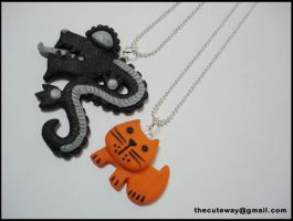 Clay necklaces cat and dragon by SaMtRoNiKa