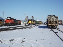 5055 Leads Train Through Snowy Railyard by Mellette