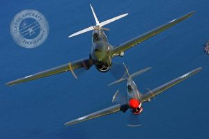 Curtiss P-40 Fighters in flight by DesertStormVet