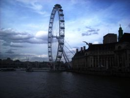 The London Eye from a bridge by loobyloukitty