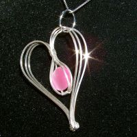 Pink Cat's Eye Heart Pendant by innerdiameter