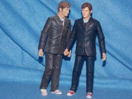 (figure) Two tennets (10th Doctor) seeing double. by spirtofthedevil
