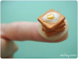Miniature eggs and toast. by Aiclay