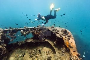 Shipwreck and diver by MotHaiBaPhoto